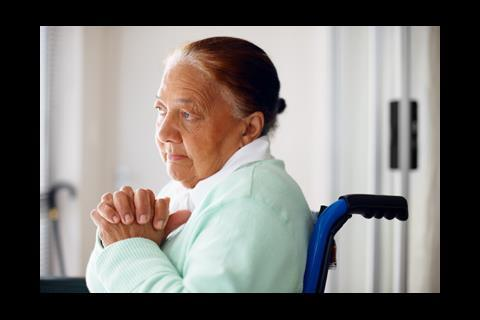 mental health depressed elderly woman wheelchair